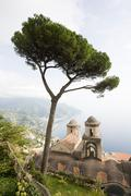 Church and tree in ravello - stock photo