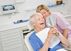 Dental assistant working on patient Stock Photos