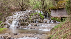 Forest waterfalls and old water mill on mountain river. Easy zoom out - stock footage