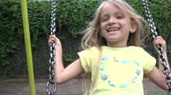 4K Happy Smiley Child Swinging, Little Girl Playing at Playground Park Children Stock Footage