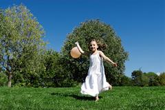 5 years old girl holding a balloon Stock Photos