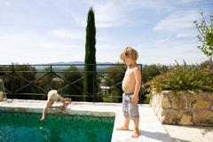 2 boys at pool - stock photo