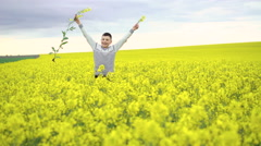 Cheerful boy cuts rape on rape and sky background. 4k Stock Footage