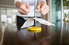 A female spiking her receipts. - stock photo