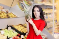 Funny Woman with Pineapple Fruit in Supermarket Stock Photos