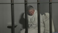 Woman in jail - elderly Stock Footage