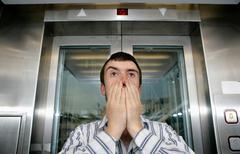 Man in lift - stock photo