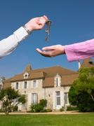 Woman receiving keys to country home Stock Photos