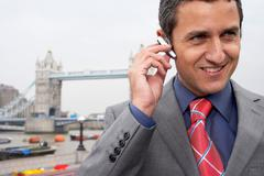 Man with bluetooth headset outside - stock photo