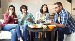 Happy people eating lunch together and chatting with each other - stock footage