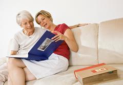 Women talking over photos Stock Photos