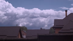 Time-lapse clouds in blue sky over roof of the brown house Stock Footage