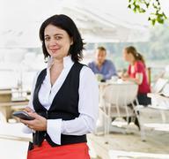 Female waitress taking orders - stock photo