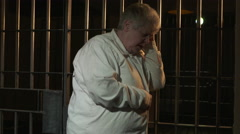 Modern Prison or Jail Scene - woman in cell Stock Footage