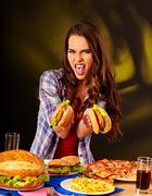Girl eating big sandwich. - stock photo