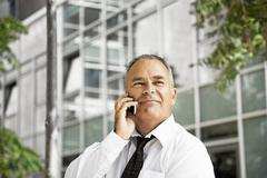 Man talking on his cellular phone Stock Photos