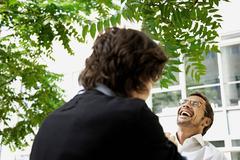 Men having a laugh, outside Stock Photos