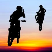 Silhouette of motocross rider jump in the sky at sunset Stock Illustration