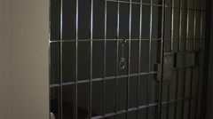 Modern Prison or Jail Scene - pan to empty cell - stock footage