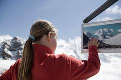 Girl looking around in mountainous area Stock Photos