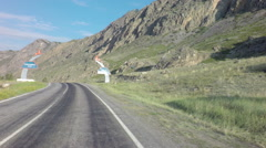 Travel by car on the Chuysky Trakt in Altai Mountains Stock Footage