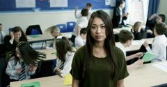 4k, Portrait of a frustrated young teacher in a classroom full of children. Stock Footage
