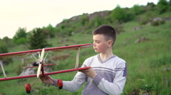 Boy plays with toy airplane on the mountain. 4k Stock Footage