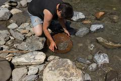 Gold Nugget mining from the River - stock photo