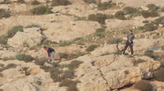 Palestinian Kids throwing stones on Israeli forces Stock Footage