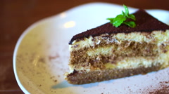 Cakes platter, Strawberry cheesecake, tiramisu, red velvet - stock footage
