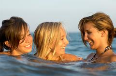 Girls teenagers playing in the sea Stock Photos