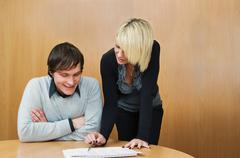 Young woman mentoring colleague Stock Photos