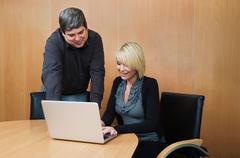 Man mentoring woman colleague Stock Photos
