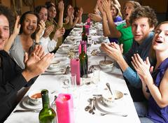 People at table,  clapping hands Stock Photos
