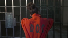 Modern Prison or Jail Scene - woman in jumpsuit - stock footage