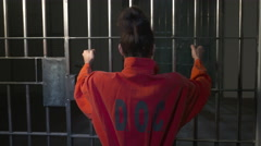 Modern Prison or Jail Scene - woman shaking bars - stock footage