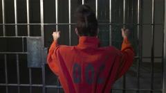 Modern Prison or Jail Scene - woman shaking bars Stock Footage