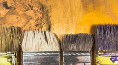 Oil paint brushes on wood painted background - stock photo