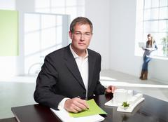 Architect at work in loft office Stock Photos