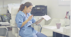 4K Medical worker alone in office writing notes on patient medical record Stock Footage