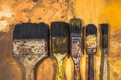 Oil paint brushes on wood painted background Stock Photos