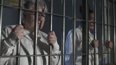 Modern Prison or Jail Scene - women holding bars of cell Stock Footage