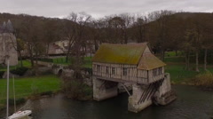The Old Mill, Vernon Normandie France, Aerial pan around Stock Footage