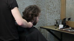 Man standing up and leaving the hairdressing salon Stock Footage