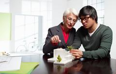 Senior and junior architects at work - stock photo