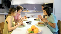 Friends liking the dinner and chatting with each other - stock footage