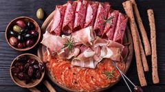 Traditional spanish tapas or italian antipasti Stock Photos