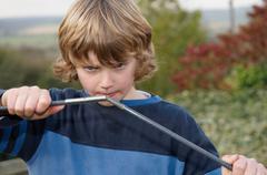 Boy erecting tent poles Stock Photos