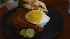Close pan of nasi lemak malaysian food dish Stock Footage