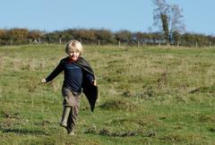 Super Hero boy in countryside Kuvituskuvat